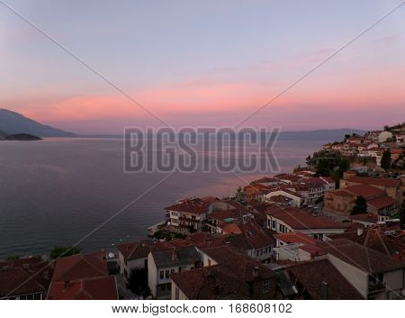 Old city by the Lake Ohrid under the breathtaking morning pink and blue sky, Macedonia
