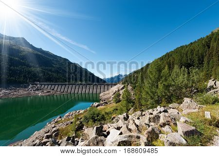 Bissina Dam (1952-1962). Straight concrete dam (563 m of length) in the National Park of Adamello Brenta. Trentino Alto Adige Italy