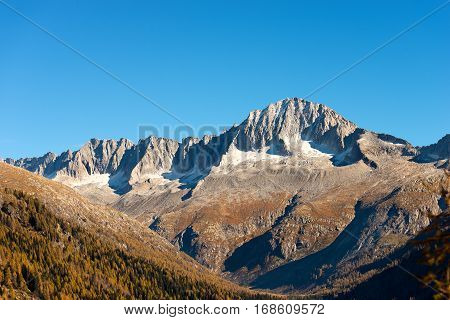 Peak of Care Alto (3462 m) in autumn in the National Park of Adamello Brenta seen from the Val di Fumo. Trentino Alto Adige Italy