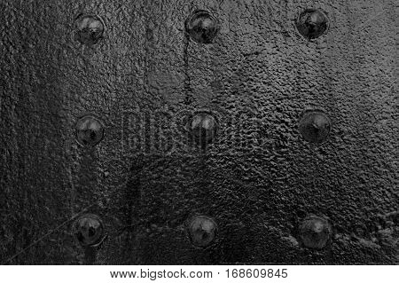 the steel plate with rivets painted on black