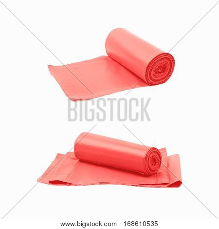 Red plastic polyethylene trash bag roll isolated over the white background, set of two different foreshortenings