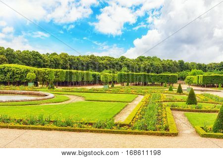"Versailees, France- July 02, 2016 : Grand Trianon Gardens Is Famous French-style Gardens ""filled Wit"