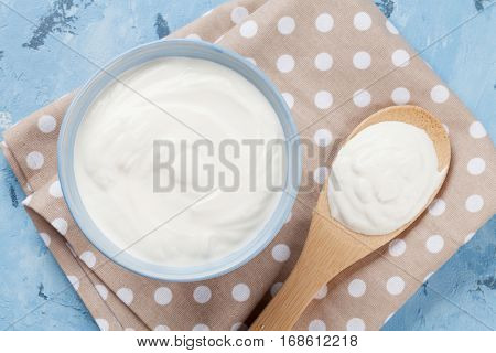 Sour cream. Dairy products on stone table. Top view