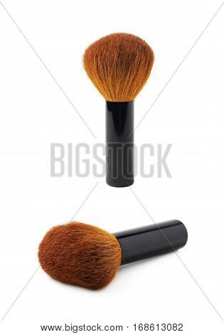 Kabuki mushroom makeup brush isolated over the white background, set of two different foreshortenings