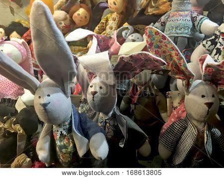 LVIV UKRAINE - FEBRUARY 02: Funny handmade dolls (rabbits) in a shop window in the centre of Lvov on February 02 2017 in Lviv Ukraine