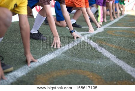 Students Boy Get Set To Leaving The Starting For Running Competition Boy At School Sports Day. Schoo