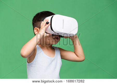 Little boy looking though the VR device