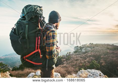 Man Traveler with big backpack hiking mountains expedition Travel Lifestyle success concept adventure active vacations outdoor mountaineering sport