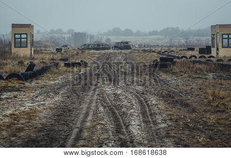 Foggy landscape of military training base, landfill