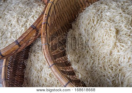 Asian dried gelatin noodles food in wooden baskets close up