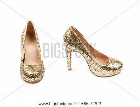 Shining golden high-heeled footwear shoe isolated over the white background, set of two different foreshortenings