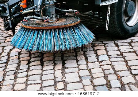 Brush cleaner. Conceptual image of environmental protection and cleaning of urban areas.