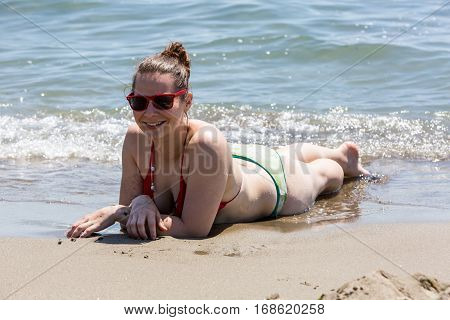 Girl At The Beach Of The Tyrrhenian Sea In The Italian Region Tuscany
