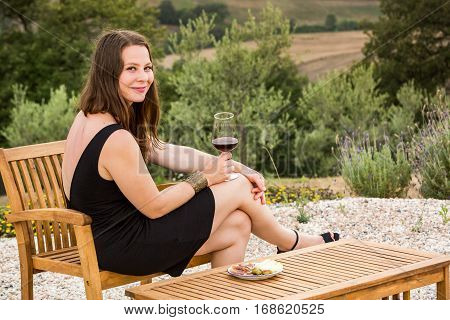Girl With A Glas Of Wine At Sunset In Tuscany, Italy