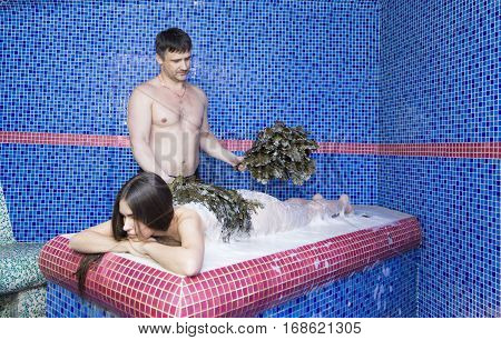 Woman on the procedure of the foam massage in the hammam