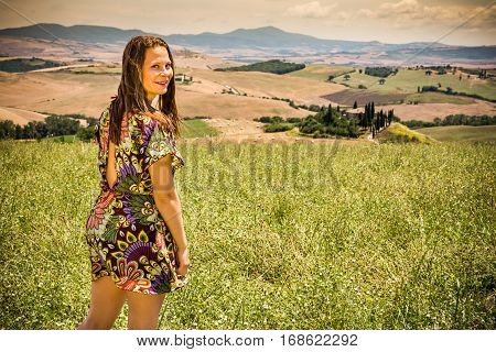 Girl Standing In The Tuscan Fields In Summer