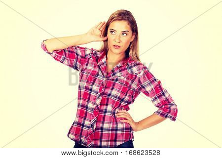 Portrait of woman overhearing a conversation