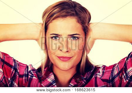 Young woman covering her ears. Hear ne evil concept