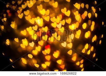 bokeh glod of heart blur on background