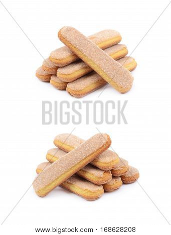 Pile of multiple ladyfinger savoiardi biscuit cookies, composition isolated over the white background, set of two different foreshortenings