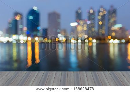 Opening wooden floor night blurred bokeh office building and water reflection abstract background