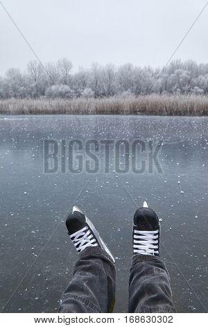 Ice skating on frozen lake
