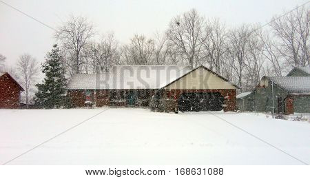 House in a snowstorm at Christmas time in winter