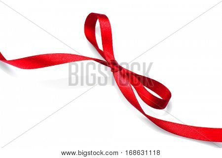 Valentine Gift Red tape bow. Elegant Red satin gift Ribbon Isolated on white. Valentine's Day Border design. Red silk ribbon curves.