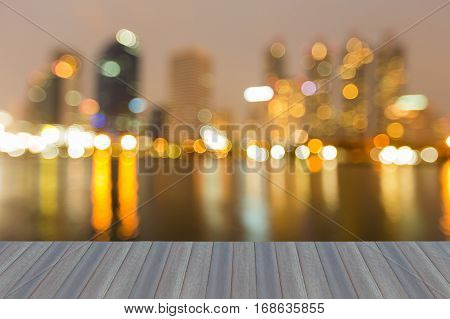 Opening wooden floor blurred bokeh city office lights night view abstract background
