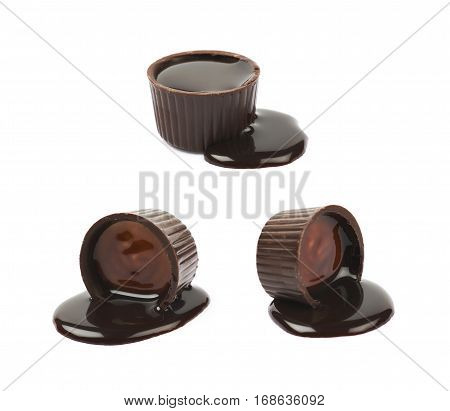 Chocolate confection candy spilled with the liquid cocoa syrup isolated over the white background, set of three different foreshortenings