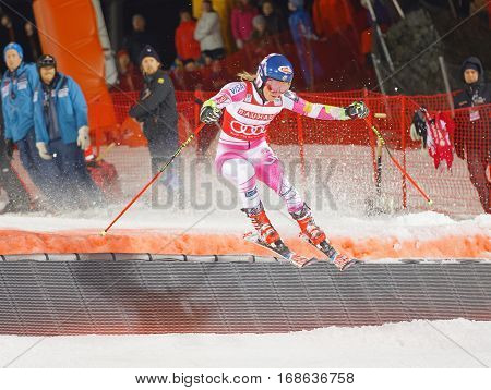 STOCKHOLM SWEDEN - JAN 31 2017: Mikaela Shiffrin (USA) makes a spectaculare jump in the downhill skiing parallel slalom event at the Alpine Audi FIS Ski World Cup. January 31 2017 Stockholm Sweden