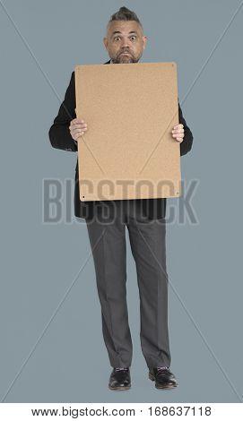 Caucasian Business Man Holding Board