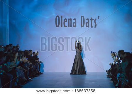 KYIV, UKRAINE - OCTOBER 16, 2016: Olena Dats makes selfie on the podium after her show during the 39th Ukrainian Fashion Week at Mystetsky Arsenal in Kyiv