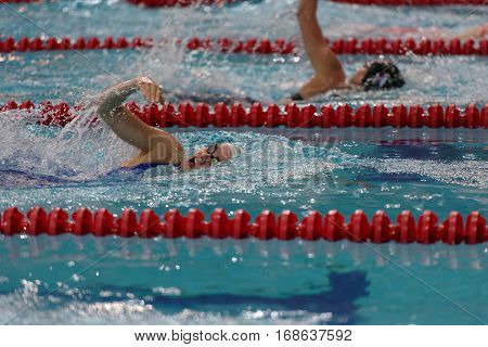 ST. PETERSBURG, RUSSIA - DECEMBER 16, 2016: Female athlete competes in 200 m backstroke swimming competition during X Salnikov Cup. Athletes from 6 countries participated in the competitions