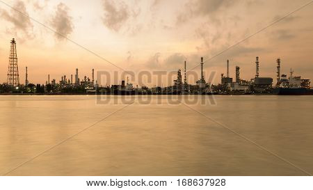 Panorama oil refinery river front with sunrise tone background
