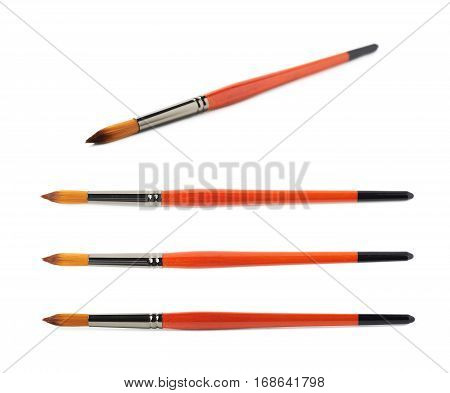 Drawing wooden paint brush isolated over the white background, set of four different foreshortenings