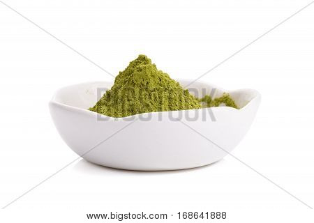 Green Tea powder on the plate on white background
