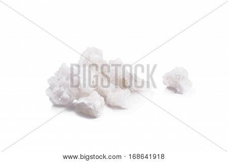 Organic sea white salt tablets on white background