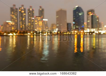City office blurred bokeh light night view and reflection abstract background