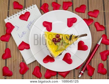 cake and red hearts written love confession