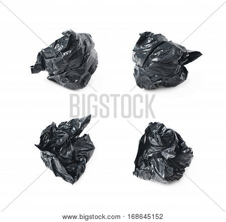 Black polyethylene trash bag crumpled in a ball isolated over the white background, set of four different foreshortenings