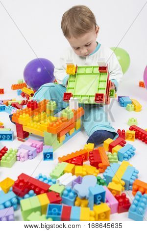 Cute little boy playing with his playing blocks
