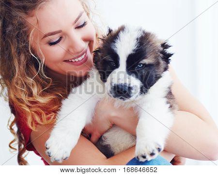 Beautiful Woman Playing With Cute Caucasian Shepherd Puppy, Dog