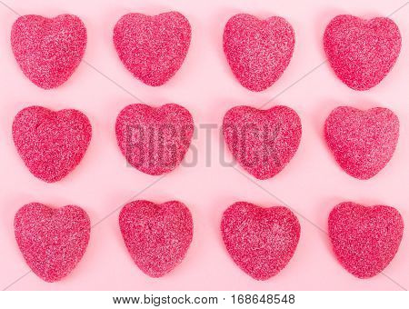 Pattern of candy heart shape on pink background