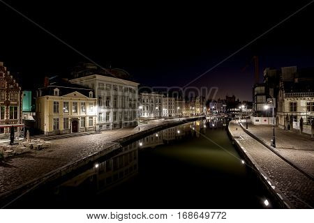 There are boats on the Graslei in Ghent during the night