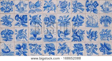 Typical old Portuguese tiles with hand painted figures in blue over white