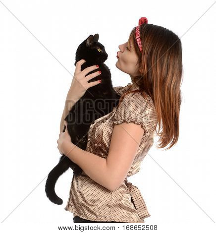 Young woman holding and kissing a black cat isolated on a white background