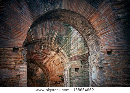 Archway closeup. Rome Forum with ruins of historical buildings. Italy.