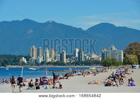 VANCOUVER, BC - AUG 17: People enjoy beach on August 17, 2015 in Vancouver, Canada. With 603k population, it is one of the most ethnically diverse cities in Canada.