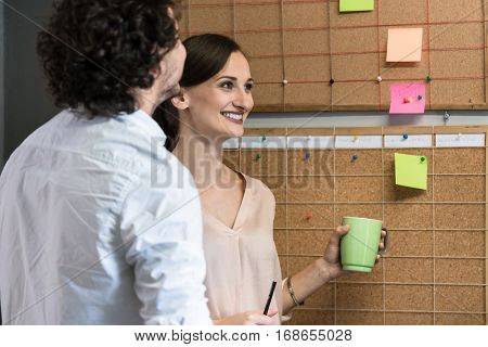 Team of agency employees in time scheduling meeting